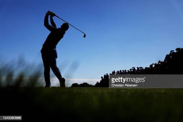 Rory McIlroy of Europe plays his shot from the 13th tee during singles matches of the 2018 Ryder Cup at Le Golf National on September 30, 2018 in...