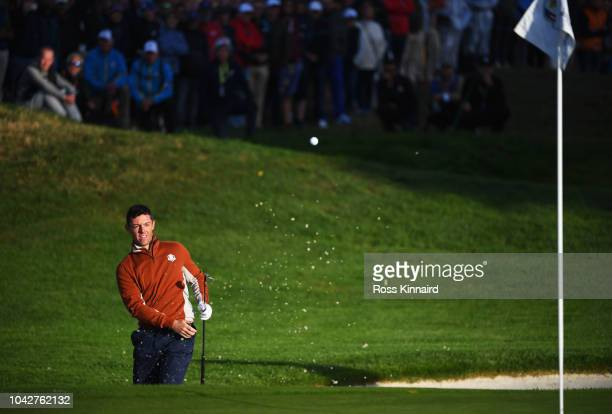 Rory McIlroy of Europe plays out of a bunker on the third during the morning fourball matches of the 2018 Ryder Cup at Le Golf National on September...