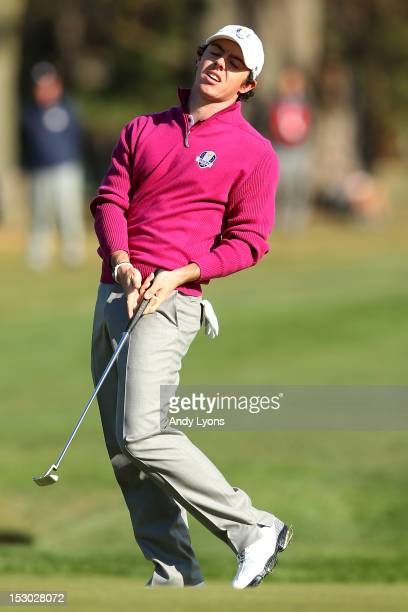 Rory McIlroy of Europe reacts after missing a birdie putt on the sixth hole during day two of the Morning Foursome Matches for The 39th Ryder Cup at...
