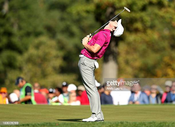 Rory McIlroy of Europe reacts after missing a putt on the seventh hole during day two of the Morning Foursome Matches for The 39th Ryder Cup at...