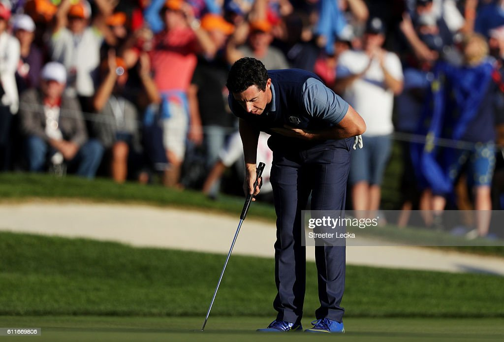 Rory McIlroy of Europe reacts on the 16th green after making a putt to win the round during afternoon fourball matches of the 2016 Ryder Cup at Hazeltine National Golf Club on September 30, 2016 in Chaska, Minnesota.