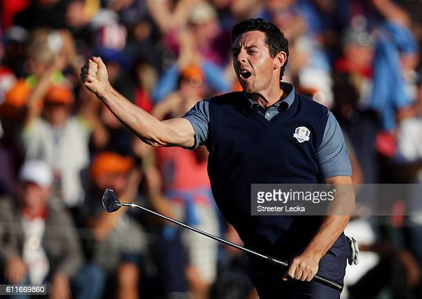 Rory McIlroy of Europe reacts on the 16th green after making a putt to win the round during afternoon fourball matches of the 2016 Ryder Cup at...