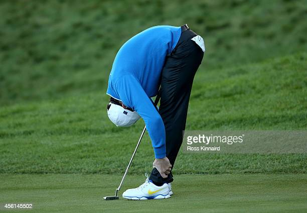 Rory McIlroy of Europe reacts on the 18th green during the Afternoon Foursomes of the 2014 Ryder Cup on the PGA Centenary course at the Gleneagles...