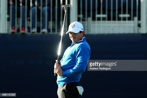 Rory McIlroy of Europe reacts to a putt on the 14th green during the Afternoon Foursomes of the 2014 Ryder Cup on the PGA Centenary course at the...