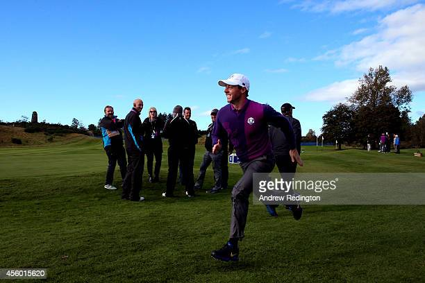Rory McIlroy of Europe runs and smiles on the course ahead of the 2014 Ryder Cup on the PGA Centenary course at the Gleneagles Hotel on September 24...