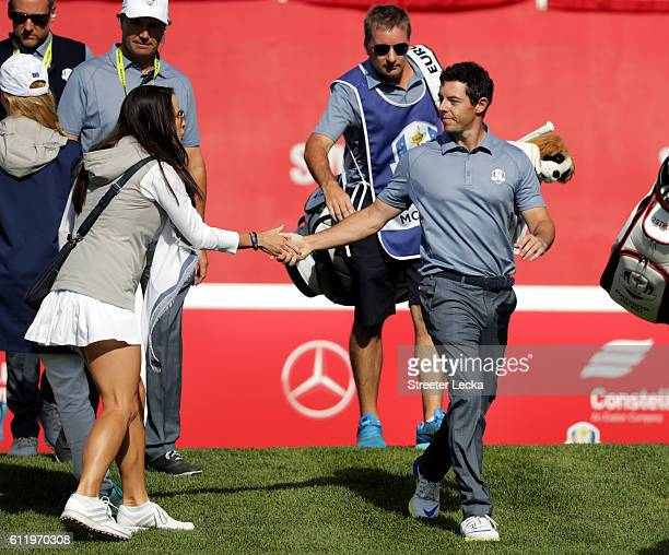 Rory McIlroy of Europe shakes hands with Angela Akins on the first tee during singles matches of the 2016 Ryder Cup at Hazeltine National Golf Club...