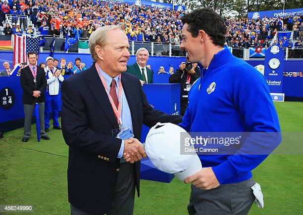 Rory McIlroy of Europe shakes with Jack Nicklaus of the United States on the 1st tee during the Singles Matches of the 2014 Ryder Cup on the PGA...
