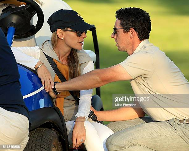 Rory McIlroy of Europe speaks to Erica Stoll during afternoon fourball matches of the 2016 Ryder Cup at Hazeltine National Golf Club on October 1...