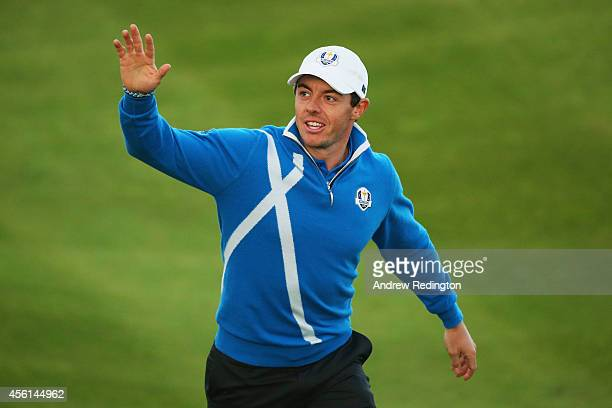 Rory McIlroy of Europe waves to the crowd after halving his match during the Afternoon Foursomes of the 2014 Ryder Cup on the PGA Centenary course at...