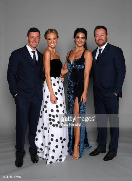 Rory McIlroy of Europe wife Erica McIlroy Gream McDowell's Wife Kristin McDowell and ViceCaptain Graeme McDowell of Europe pose for a portrait before...