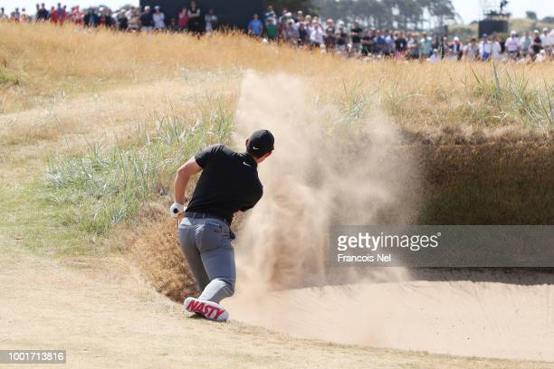 Rory McIlroy of Ireland hits his second shot from a bunker on the first hole during the first round of the 147th Open Championship at Carnoustie Golf...