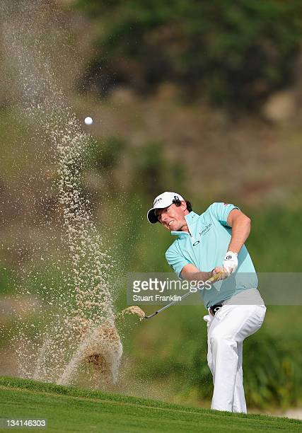 Rory McIlroy of Ireland plays a bunker shot on the 15th hole during the final days foursomes at the Omega Mission Hills World Cup at the Mission...