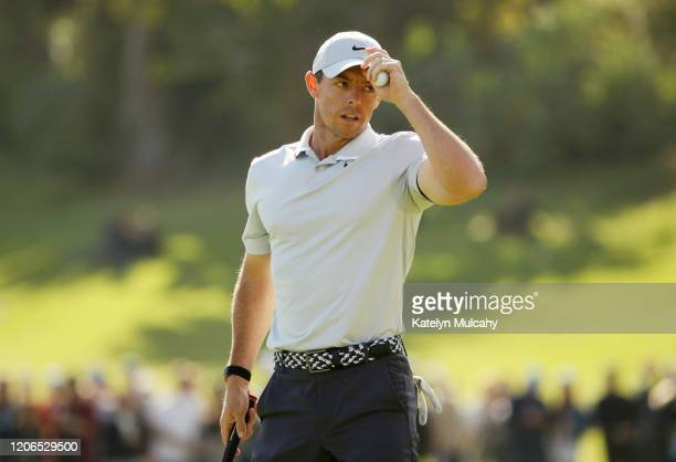 Rory McIlroy of Northern Ireland acknowledges the crowd after finishing on the 18th green during the third round of the Genesis Invitational at...