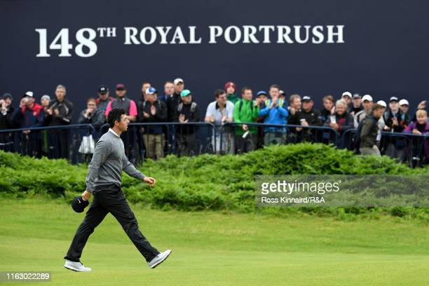 Rory McIlroy of Northern Ireland acknowledges the crowd as he walks off the 18th hole following his second round of the 148th Open Championship held...