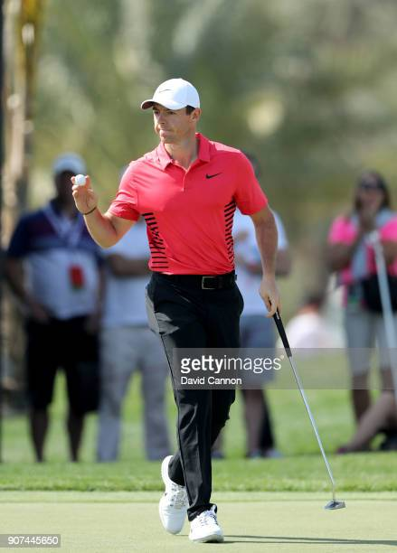 Rory McIlroy of Northern Ireland acknowledges the crowd on the par 4 first hole during the third round of the 2018 Abu Dhabi HSBC Golf Championship...