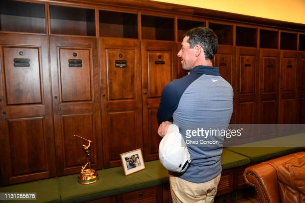 Rory McIlroy of Northern Ireland admires his locker in the Champions locker room after the final round of THE PLAYERS Championship on THE PLAYERS...