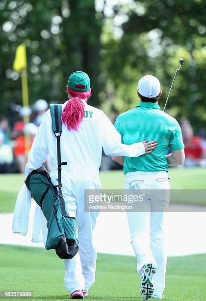 Rory McIlroy of Northern Ireland alongside his caddie/girlfriend Caroline Wozniacki during the 2014 Par 3 Contest prior to the start of the 2014...