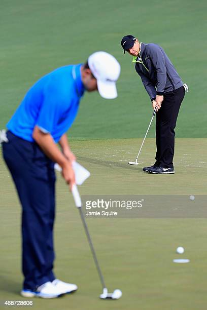 Rory McIlroy of Northern Ireland and amateur Bradley Neil of Scotland putt during a practice round prior to the start of the 2015 Masters Tournament...