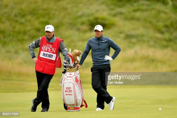 Rory McIlroy of Northern Ireland and caddie JP Fitzgerald look on from the 17th hole during the second round of the 146th Open Championship at Royal...