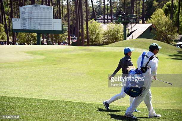 Rory McIlroy of Northern Ireland and caddie JP Fitzgerald walk from the fourth green during the third round of the 2016 Masters Tournament at Augusta...