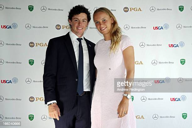 Rory McIlroy of Northern Ireland and Caroline Wozniacki of Denmark attend the US Golf Writers Dinner on April 10 2013 in Augusta Georgia