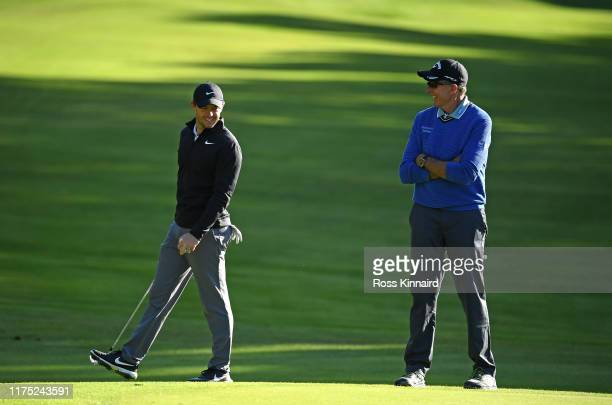 Rory McIlroy of Northern Ireland and David Leadbetter during a practice round prior to the BMW PGA Championship at Wentworth Golf Club on September...