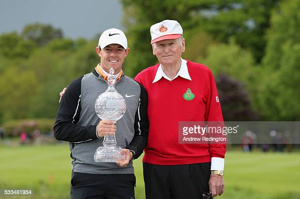 Rory McIlroy of Northern Ireland and Dr Michael Smurfit the owner of The K Club pose with the trophy after winning the Dubai Duty Free Irish Open...