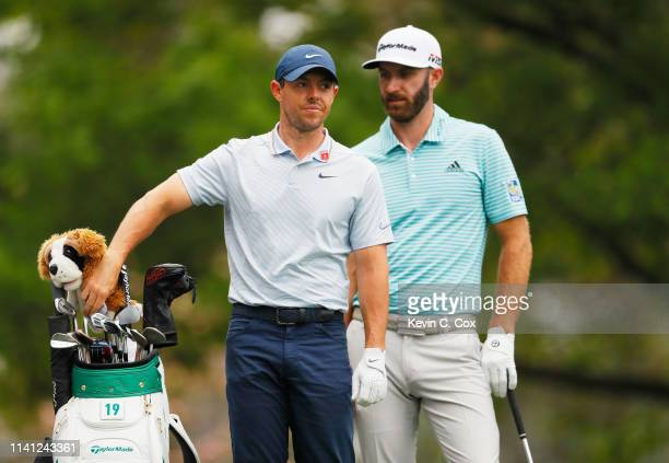 Rory McIlroy of Northern Ireland and Dustin Johnson of the United States prepare to play form the fourth tee during a practice round prior to The...