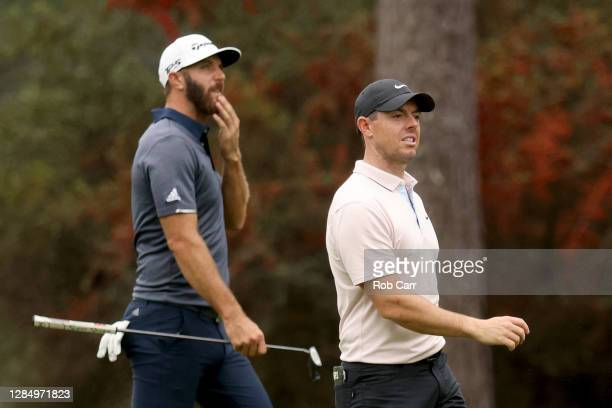 Rory McIlroy of Northern Ireland and Dustin Johnson of the United States walk together during a practice round prior to the Masters at Augusta...