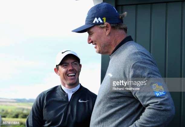 Rory McIlroy of Northern Ireland and Ernie Els of South Africa share a joke whilst they wait on a tee box during day one of the 2017 Alfred Dunhill...