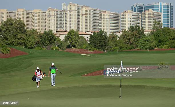 Rory McIlroy of Northern Ireland and his caddie JP Fitzgerald approach the eighth green during the third round of the DP World Tour Championship on...