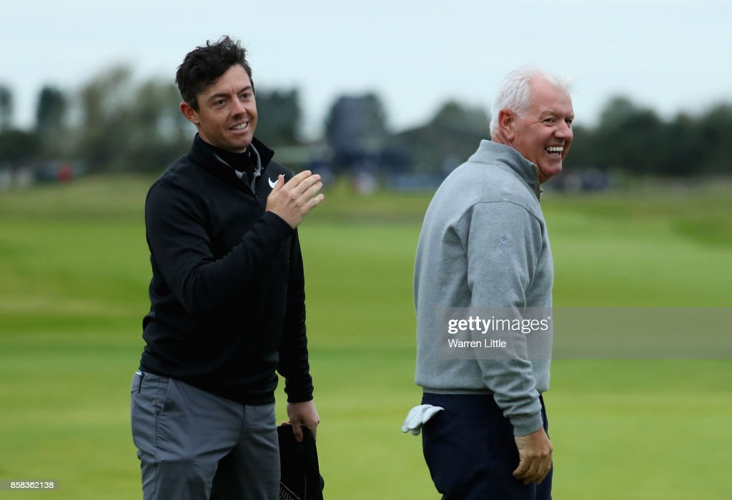 Rory McIlroy of Northern Ireland and his Dad Gerry McIlroy react on the 18th during day two of the 2017 Alfred Dunhill Championship at Carnoustie on October 6, 2017 in St Andrews, Scotland.