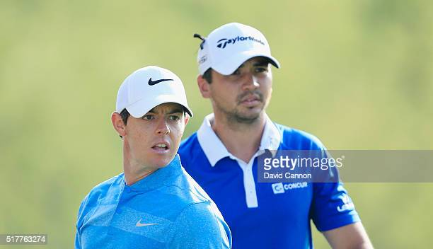 Rory McIlroy of Northern Ireland and Jason Day of Australia watch a tee shot on the third hole during their semifinal match at the World Golf...