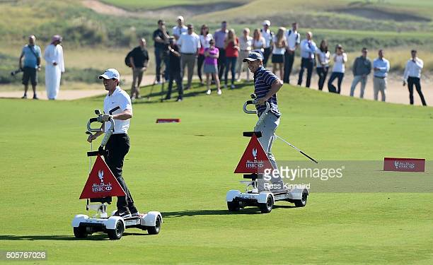 Rory McIlroy of Northern Ireland and Jordan Spieth of the United States pictured riding a Golfboard in 'The Rider Cup Desert Challenge' at Saadiyat...