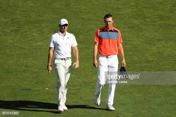 Rory McIlroy of Northern Ireland and Jordan Spieth of the United States walk the tenth hole during the first round of the 2018 US Open at Shinnecock...