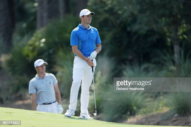 Rory McIlroy of Northern Ireland and Justin Thomas of the United States looks on from the tenth hole during the second round of THE PLAYERS...