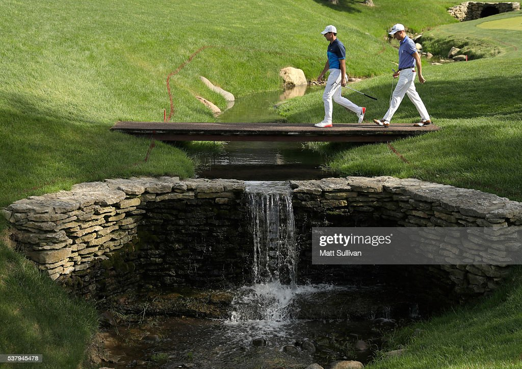 Rory McIlroy of Northern Ireland and Justin Thomas walk to the green on the 17th hole during the second round of The Memorial Tournament at Muirfield Village Golf Club on June 3, 2016 in Dublin, Ohio.