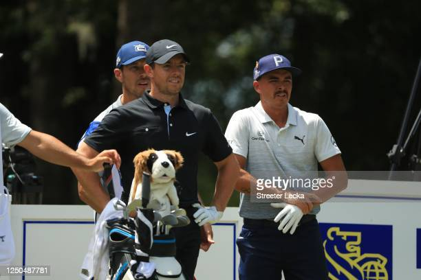 Rory McIlroy of Northern Ireland and Rickie Fowler of the United States look on from the ninth tee during the first round of the RBC Heritage on June...