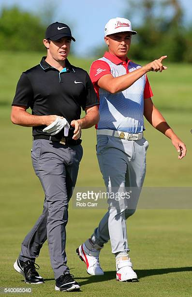 Rory McIlroy of Northern Ireland and Rickie Fowler of the United States walk on the 12th hole during a practice round prior to the US Open at Oakmont...