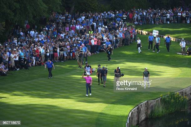 Rory McIlroy of Northern Ireland and Sam Horsfield of England walk onto the 18th green during the third round of the BMW PGA Championship at...