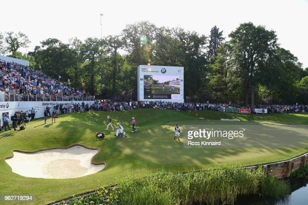Rory McIlroy of Northern Ireland and Sam Horsfield of England walk off the 18th green during the third round of the BMW PGA Championship at Wentworth...