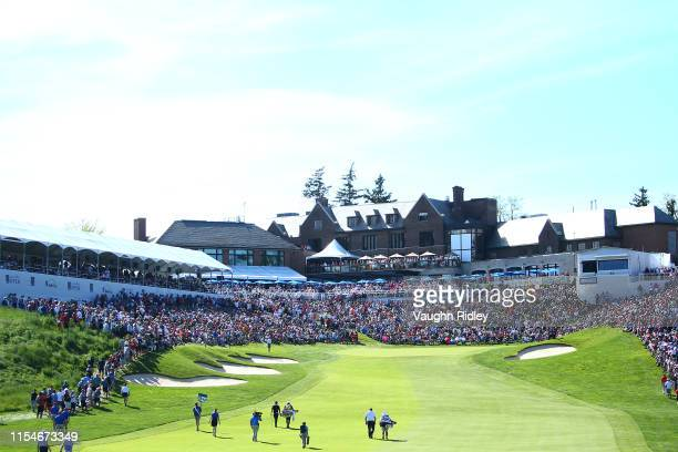 Rory McIlroy of Northern Ireland and Sepp Straka of the United States walk up to the 18th green during the third round of the RBC Canadian Open at...