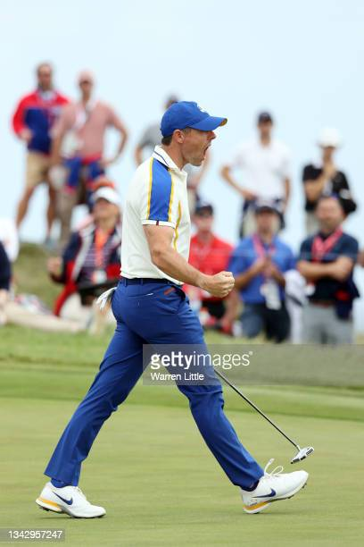 Rory McIlroy of Northern Ireland and team Europe celebrates on the 14th green during Sunday Singles Matches of the 43rd Ryder Cup at Whistling...