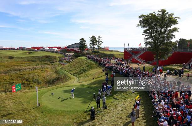Rory McIlroy of Northern Ireland and team Europe plays his shot from the 10th tee during Friday Morning Foursome Matches of the 43rd Ryder Cup at...