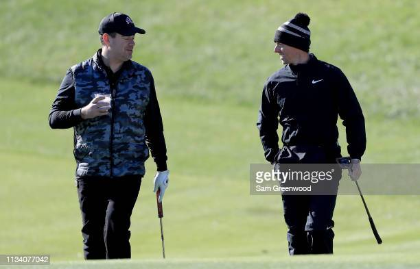 Rory McIlroy of Northern Ireland and Television host Carson Daly speak during the proam round prior to the Arnold Palmer Invitational Presented By...