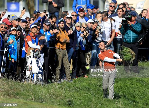 Rory McIlroy of Northern Ireland and the European Team plays his second shot on the 17th hole in his match with Sergio Garcia against Brooks Koepka...
