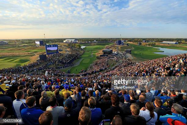 Rory McIlroy of Northern Ireland and the European Team plays his tee shot on the first hole in his match with Thorbjorn Olesen of Denmark against...