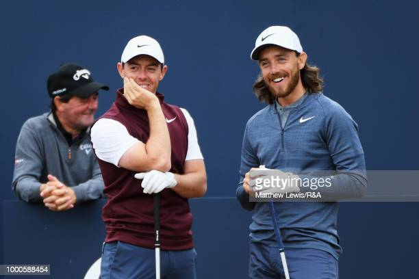 Rory McIlroy of Northern Ireland and Tommy Fleetwood of England prepare to tee off at the 1st hole while practicing during previews to the 147th Open...