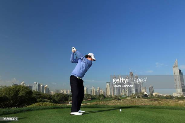 Rory McIlroy of Northern Ireland at the 8th hole during the proam as a preview for the 2010 Omega Dubai Desert Classic on the Majilis Course at the...