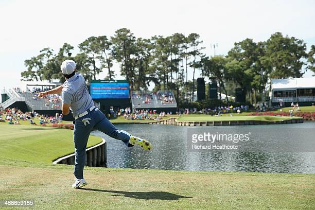 Rory McIlroy of Northern Ireland attempts to throw a ball onto the 17th green from the tee box during a practice round ahead of THE PLAYERS...